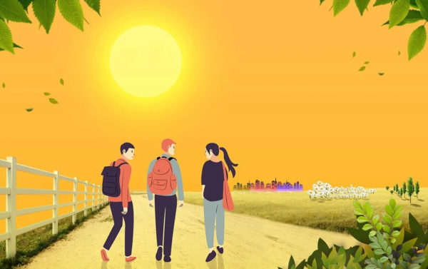 Three young people walking on a country road with a city in the distance